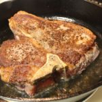 cooking steak with cast iron