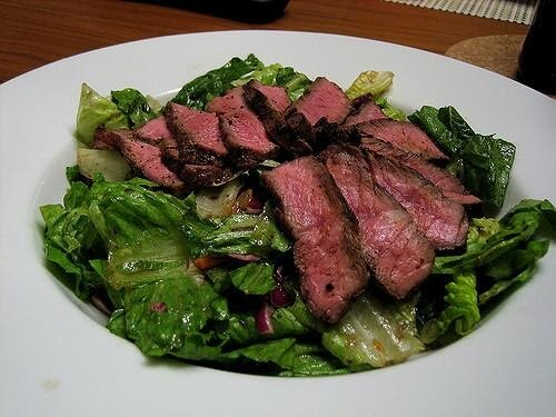 cooked steak on a salad